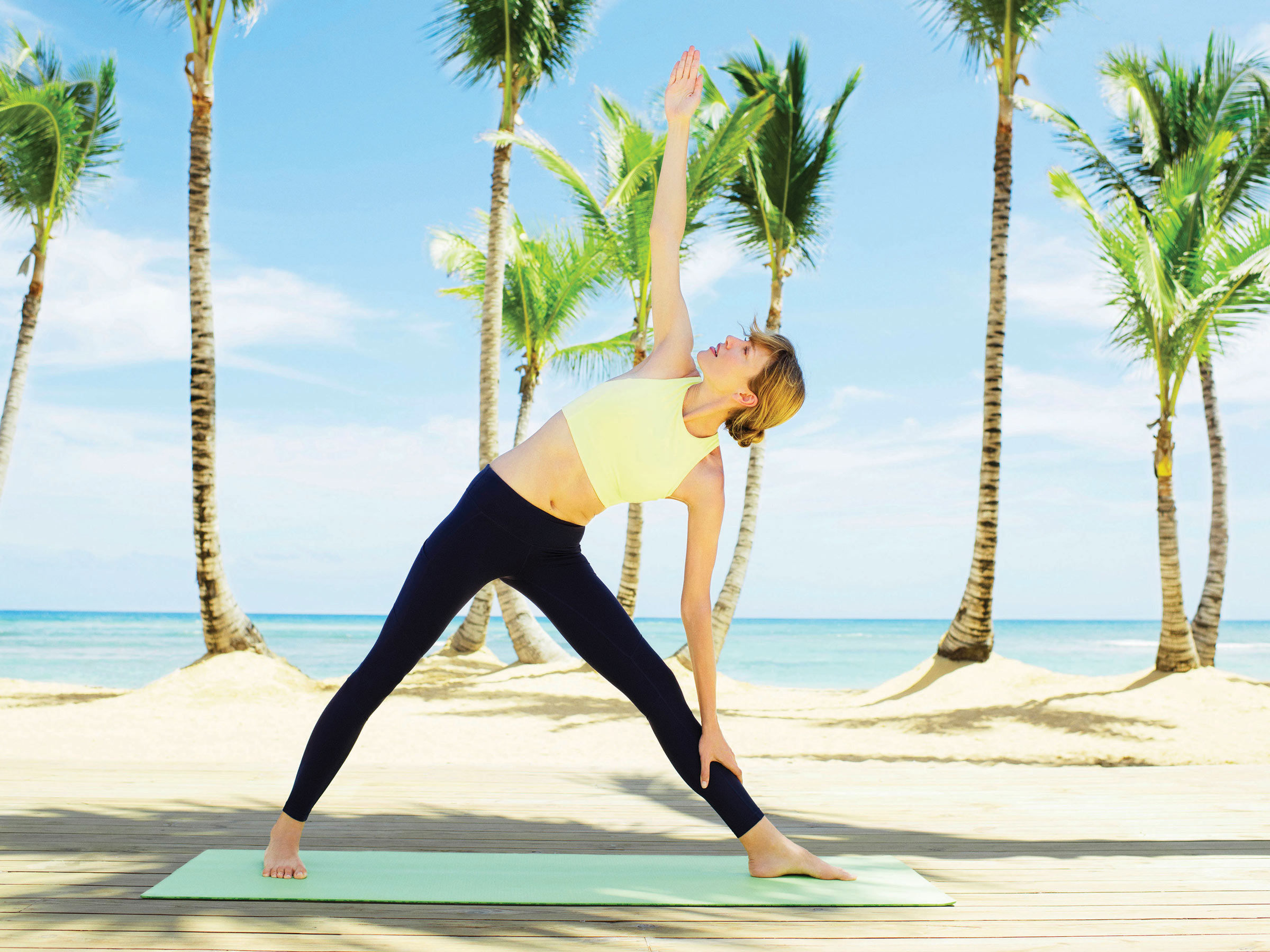 Stay Fit with Beach Yoga Sessions at Excellence El Carmen Resort